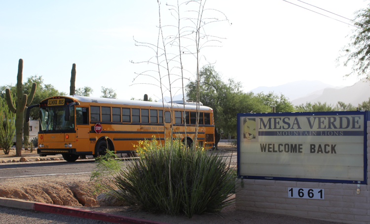 School bus drives by Mesa Verde Elementary School