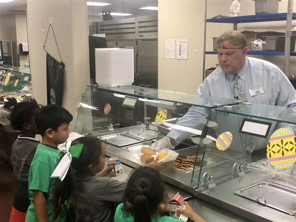 Superintendent Todd Jaeger feeding students